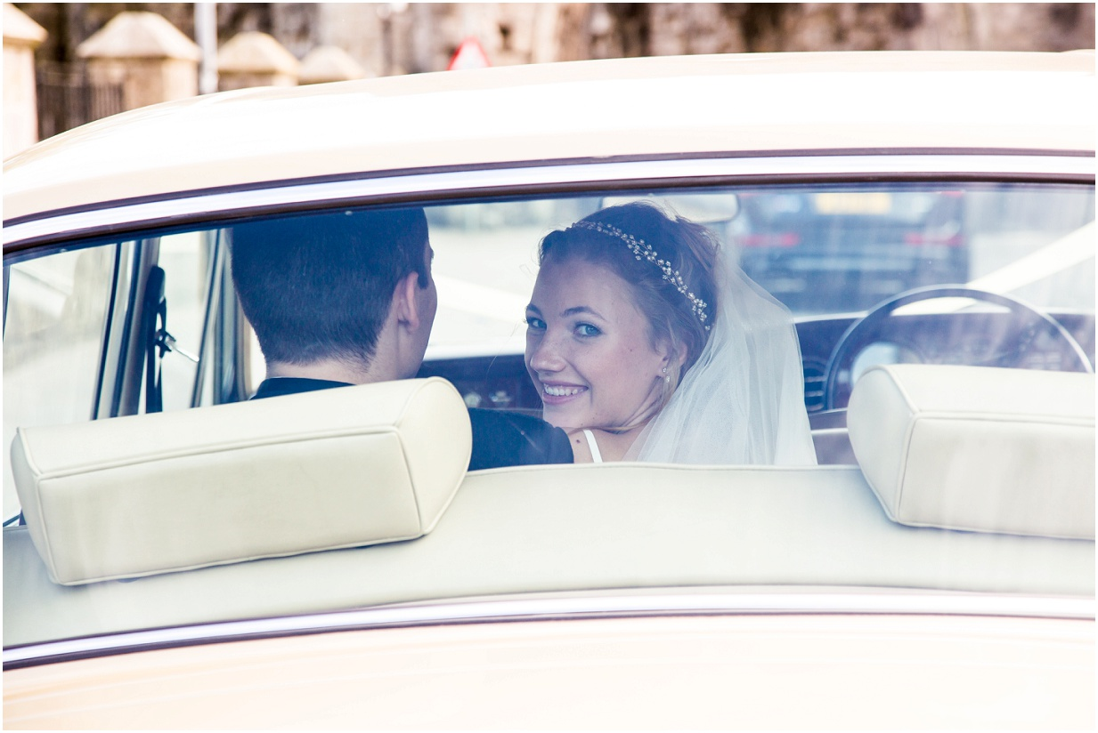 married! Photograph of bride in Rolls Royce wedding car
